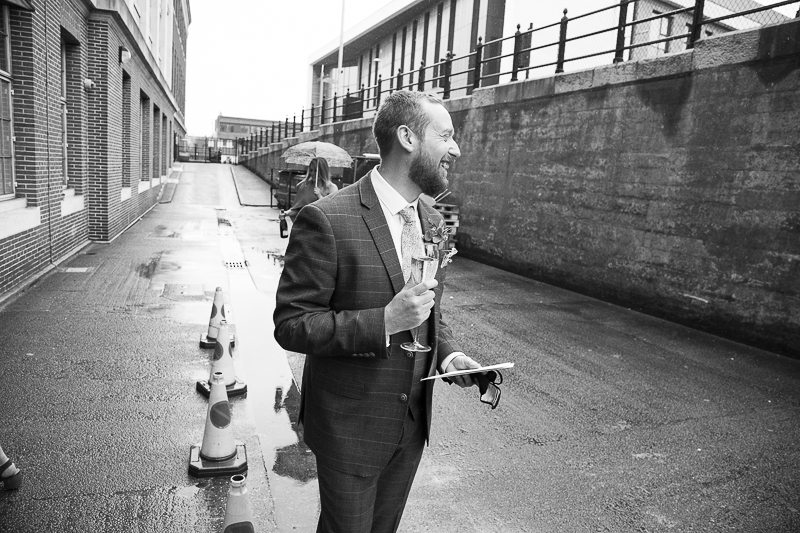 Groom with prosecco at the back of Barnsley Town Hall
