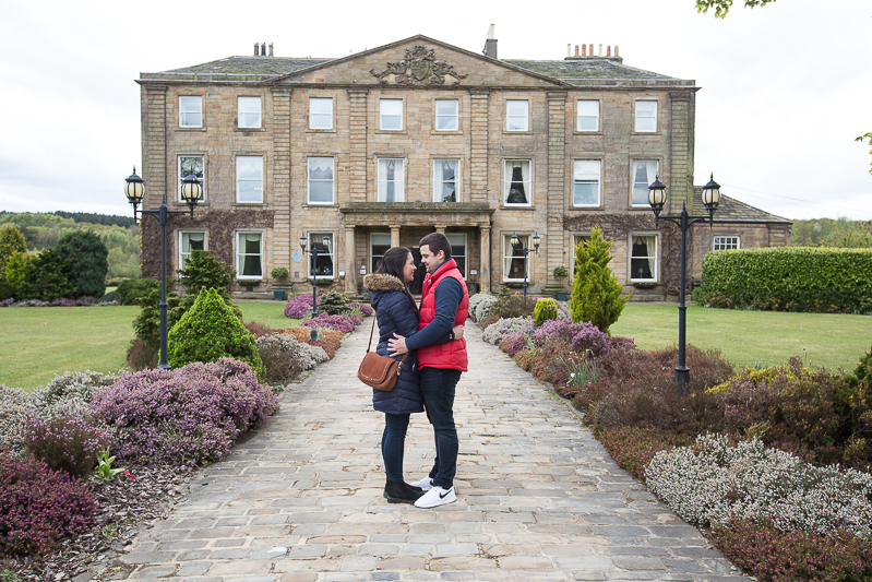 Couple in front of the building at Waterton Park and Walton Hall Hotel