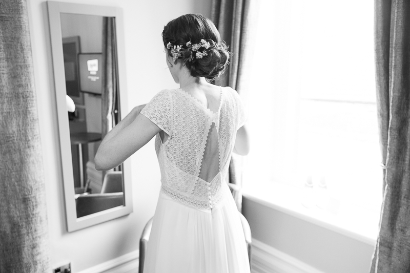 Bride looking in the mirror at Cubley Hall Penistone, Sheffield