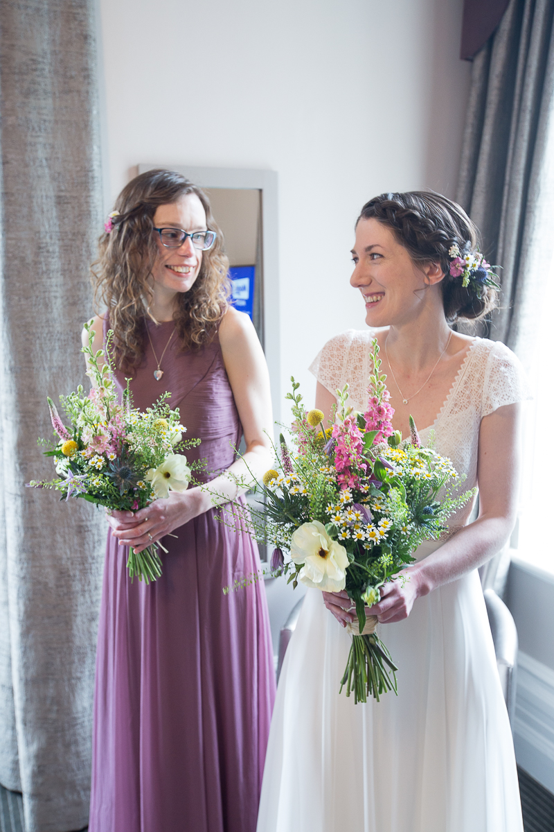 Bride and bridesmaid before the wedding ceremony at Cubley Hall Hotel