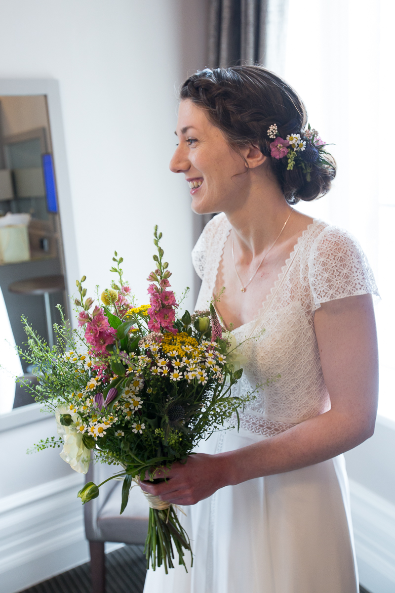 Bride before the ceremony with flowers by Hacketts florist in Penistone