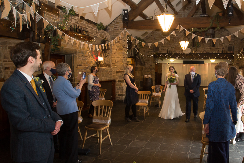 Bride walking down the aisle socially distanced with dad South Yorkshire wedding photographer