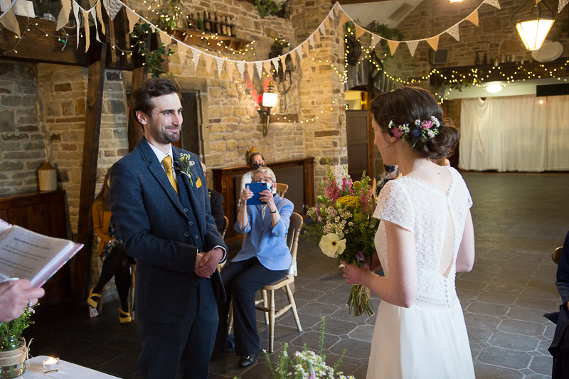 Couple exchanging vows at Cubley Hall South Yorkshire wedding photographer