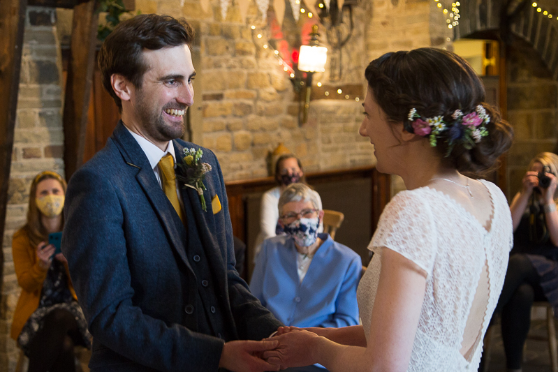 Couple smiling at each other during Cubley Hall Wedding ceremony South Yorkshire wedding photographer