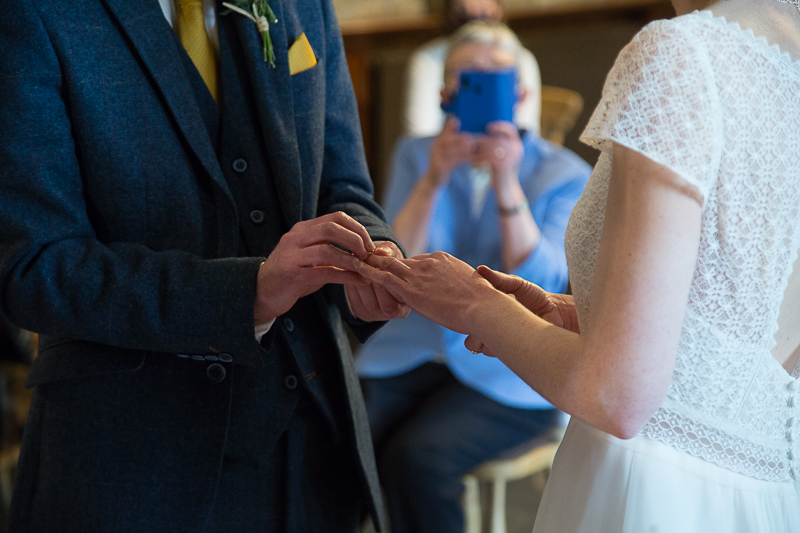 Couple exchanging rings South Yorkshire wedding photographer