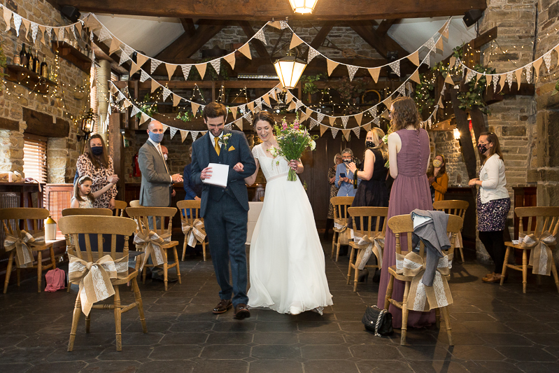 Newlyweds dnacing back up the aisle after ceremony at Cubley hall Hotel Sheffield
