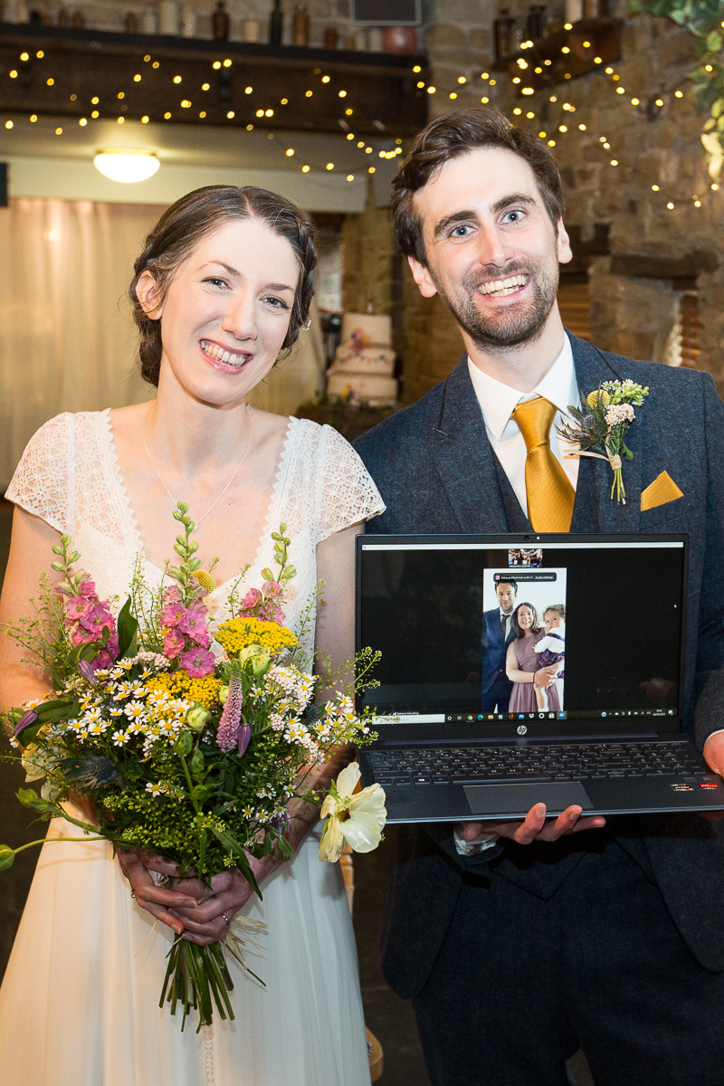 Bride and groom with their virtuakt guests covid wedding in Cubley Hall Hotel
