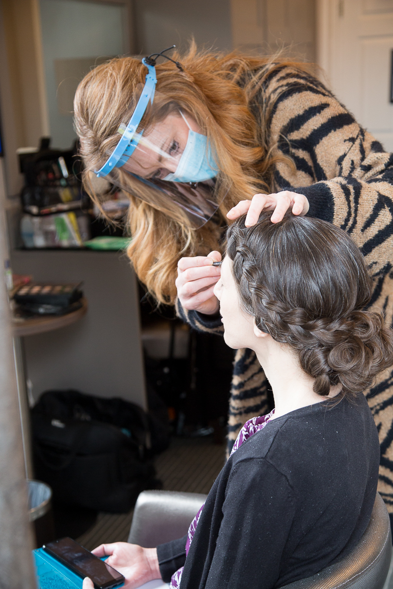Bride and makeup artist during a covid wedding