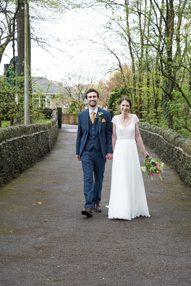 Bride and groom walking and laughing at Cubley Hall Hotel Sheffield