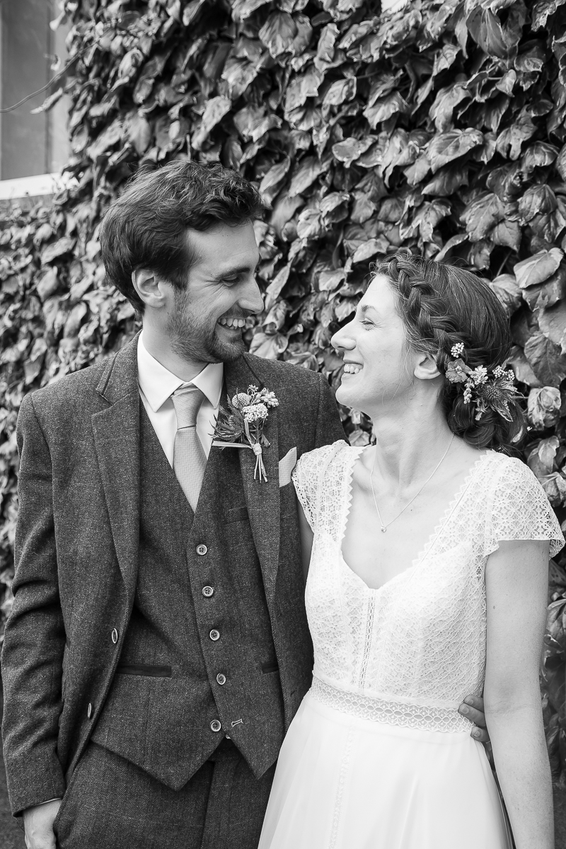 Bride and groom laughing after their wedding ceremony at Cubley Hall Hotel Sheffield