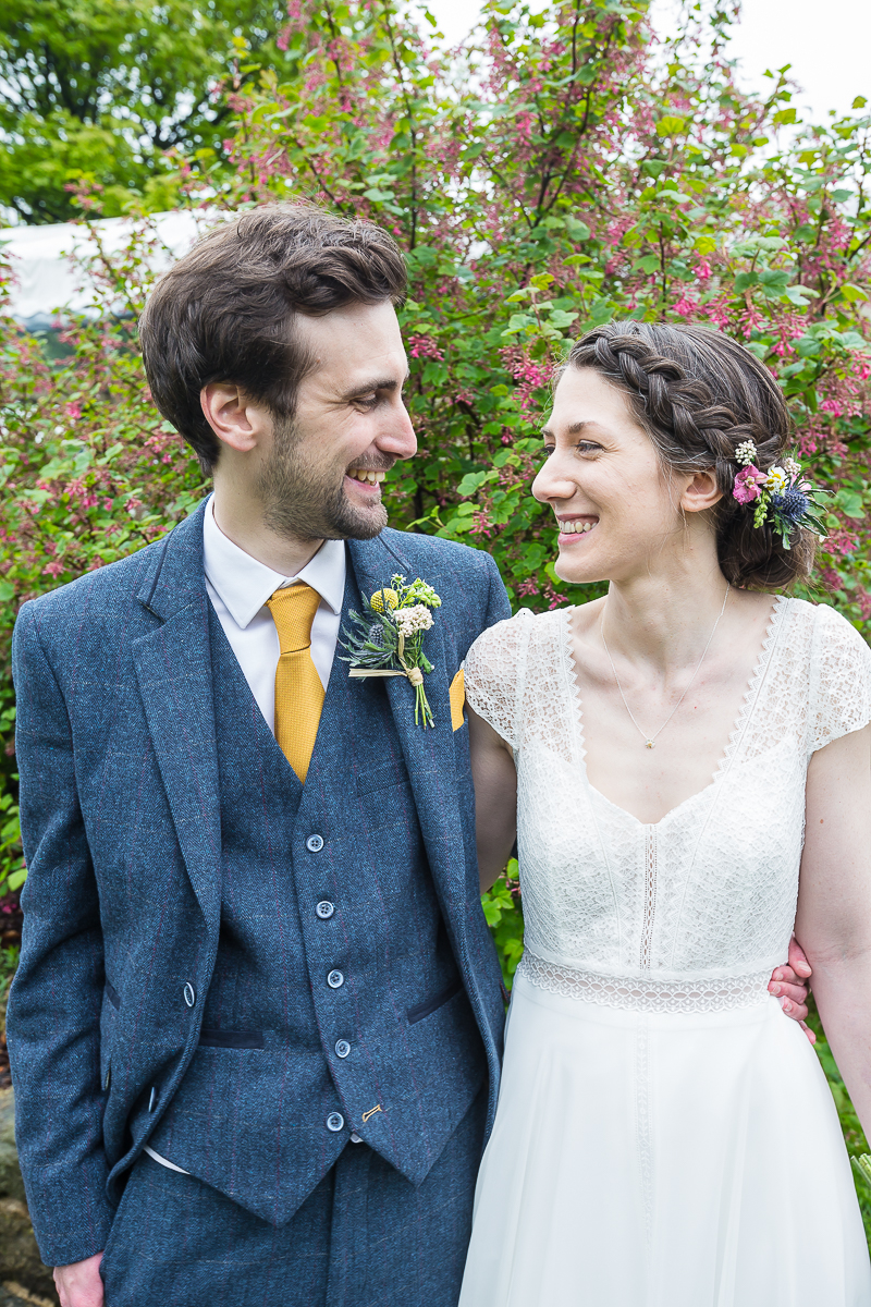 Bride and groom smiling at each other at Cubley Hall Hotel Penistone