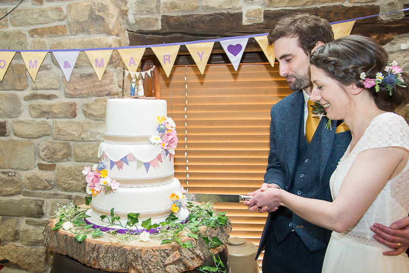 Cutting the wedding cake at Cubley Hall South Yorkshire