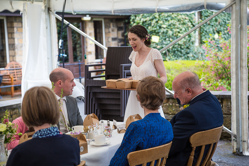 Bride handing out cake at Cubley Hall South Yorkshire
