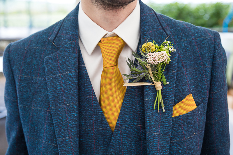 Grooms suit and buttonhole at Cubley Hall wedding
