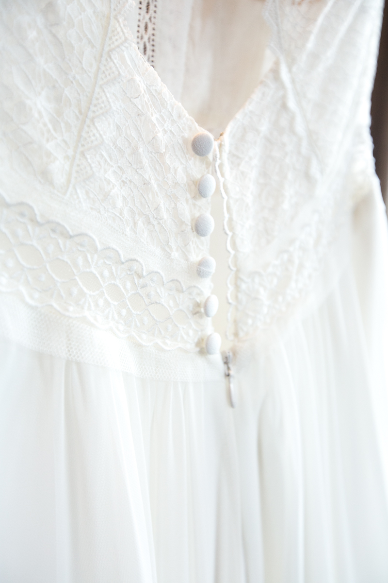 Button detail on a rembo styling wedding dress
