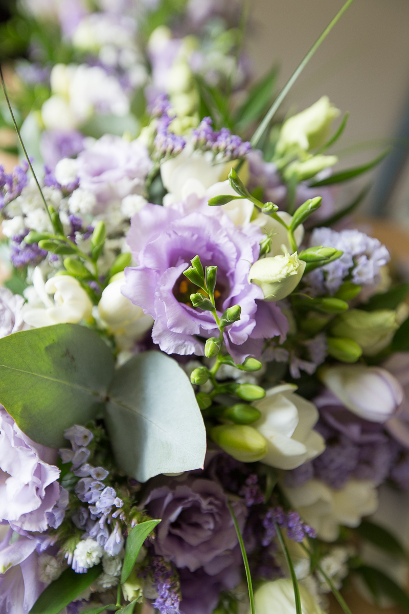 Purple white and green wedding flowers