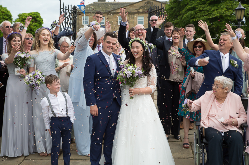 Guests throwing confetti at Waterton Park Hotel
