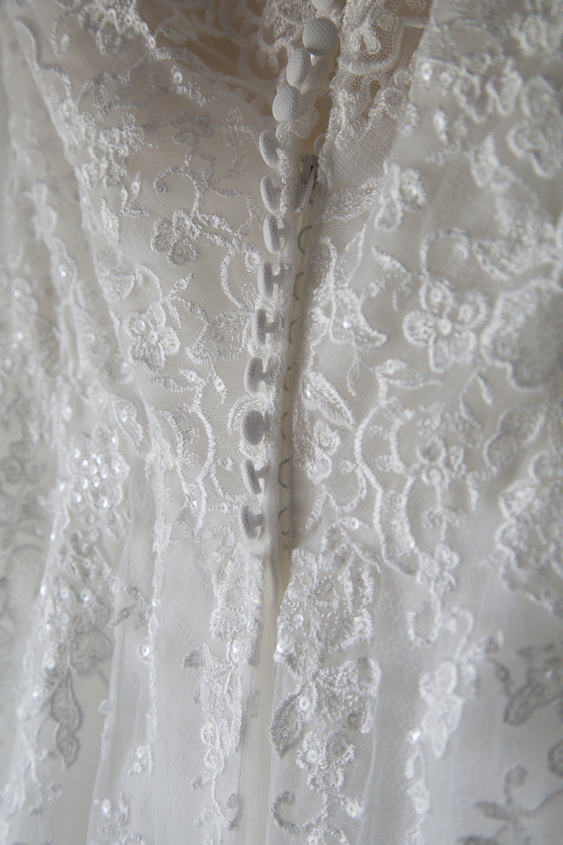 Wedding dress details with buttons and lace