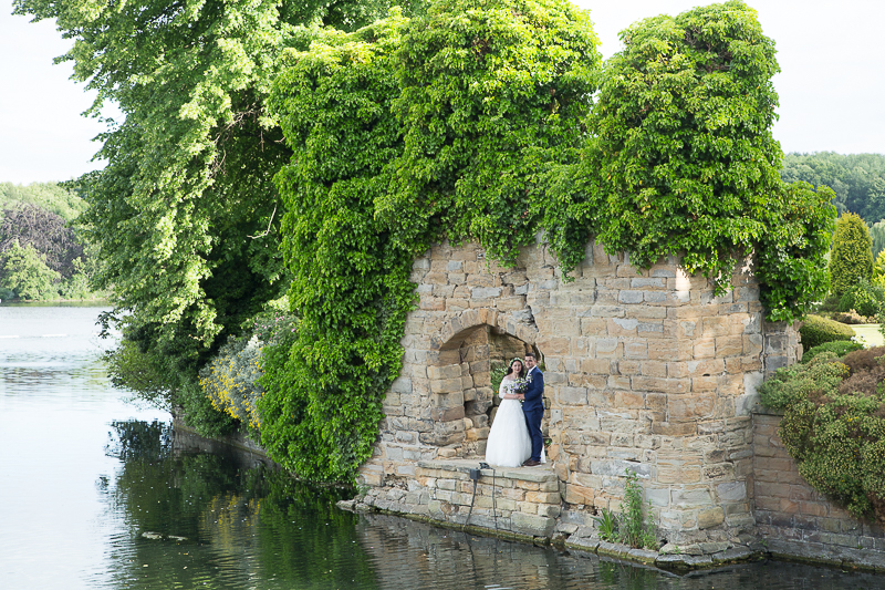 Bride and groom in the hole in the wall at Waterton Park Hotel