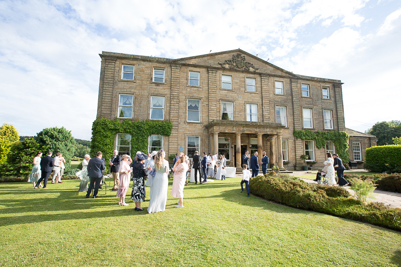 Guests drinks reception on the lawn at Waterton Park Hotel wedding