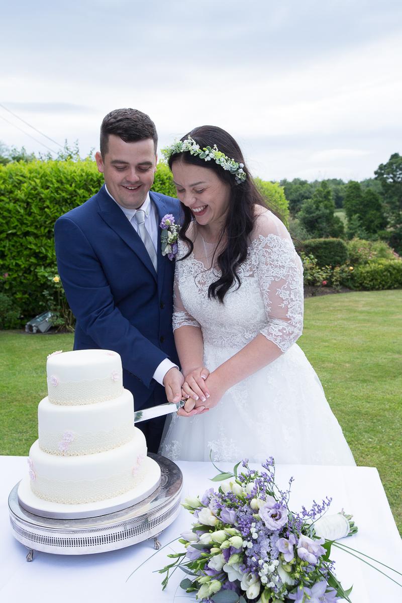 Bride & Groom cutting the cake at Waterton Park Hotel wedding