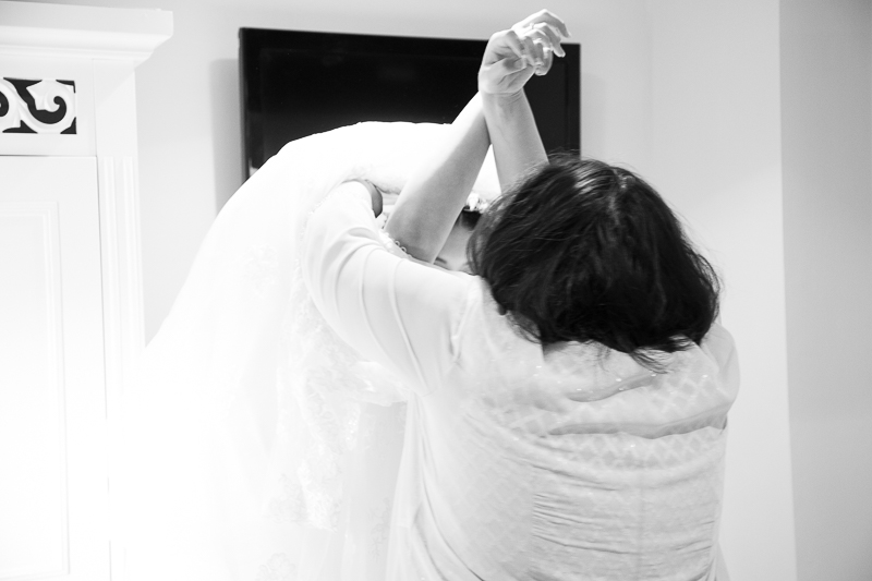 Mother of the bride helping fasten the wedding dress at Waterton Park Hotel Yorkshire