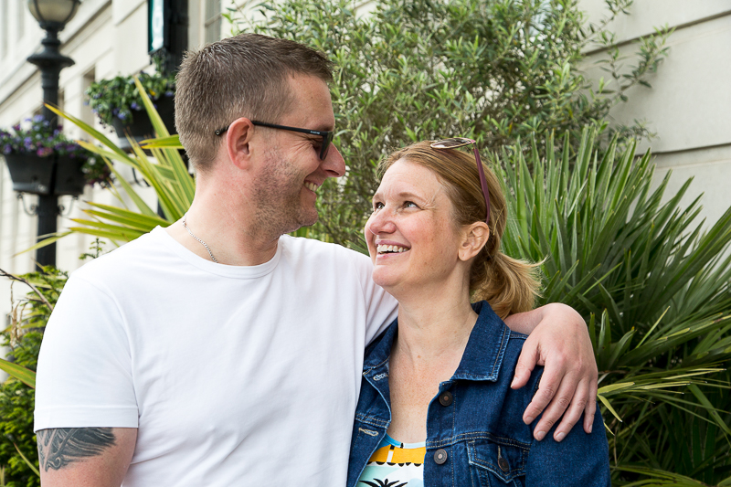 Couple smiling in front of the large green plants outside Barnsley Town Hall South Yorkshire