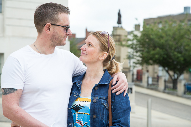 Couple smiling with cenotaph in background Barnsley