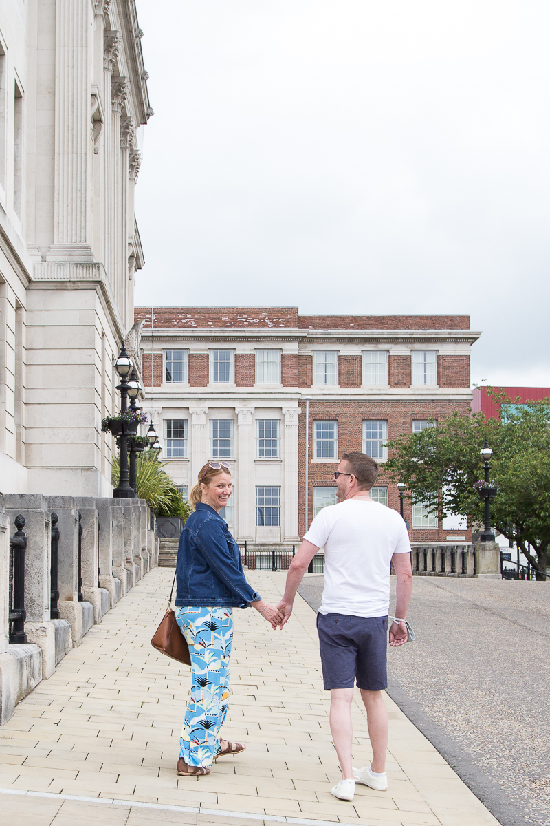 Couple walking away from camera outside Barnsley town hall
