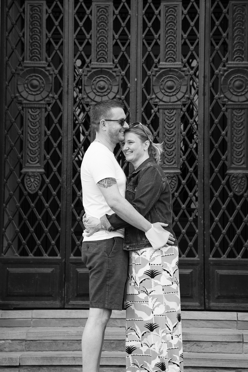 Black and white couple laughing outside Barnsley Town Hall South Yorkshire
