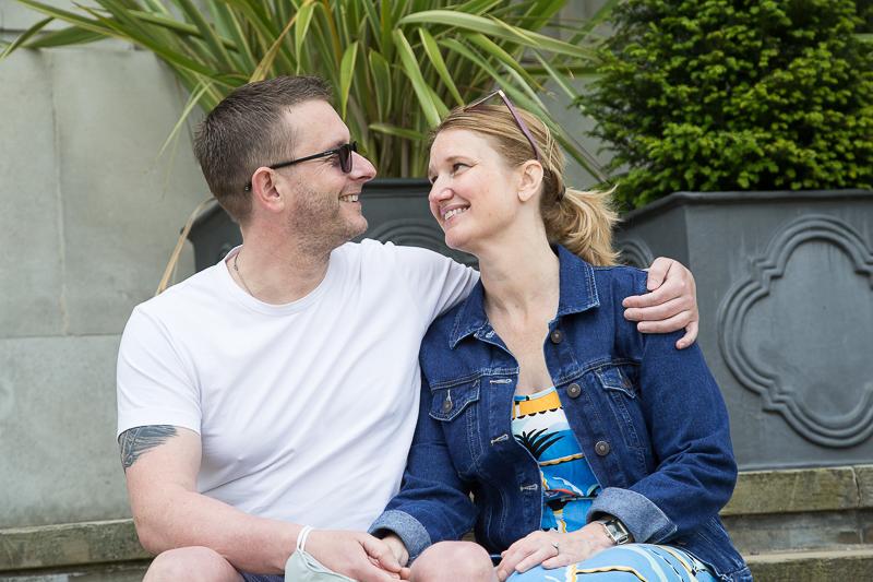 Couple sitting on steps outside barnsley town hall