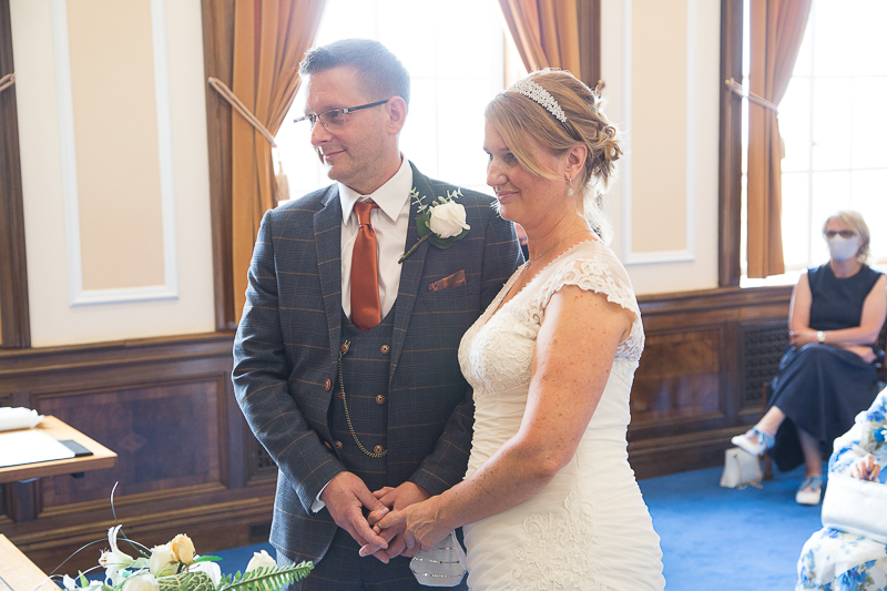 Coupld exchange vows during their wedding ceremony at Barnsley Town Hall