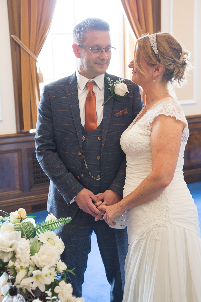COuple smile at each other during their wedding ceremony at Barnsley Town Hall