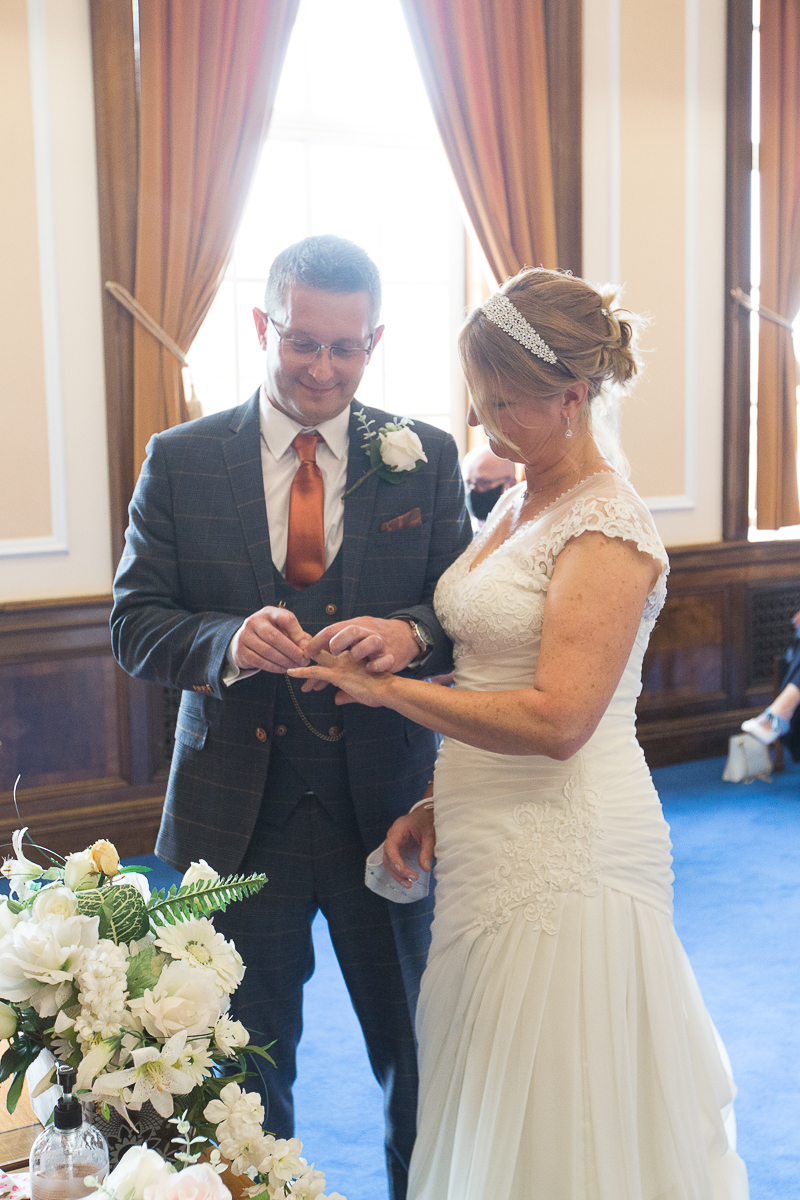 Couple exchange rings during the wedding ceremony at Barnsley Town Hall