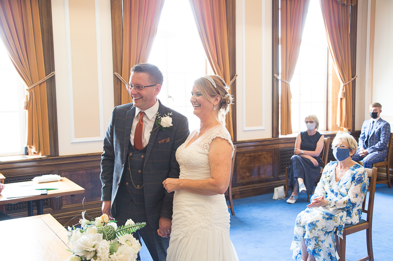 Couple laughing during the wedding ceremony at Barnsley Town Hall