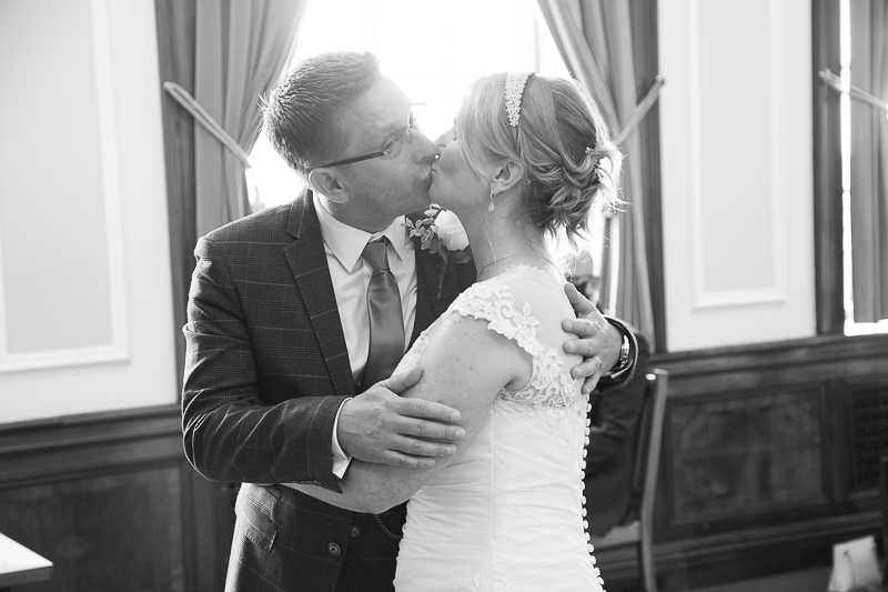 Couple kiss after their wedding ceremony at Barnsley Town Hall