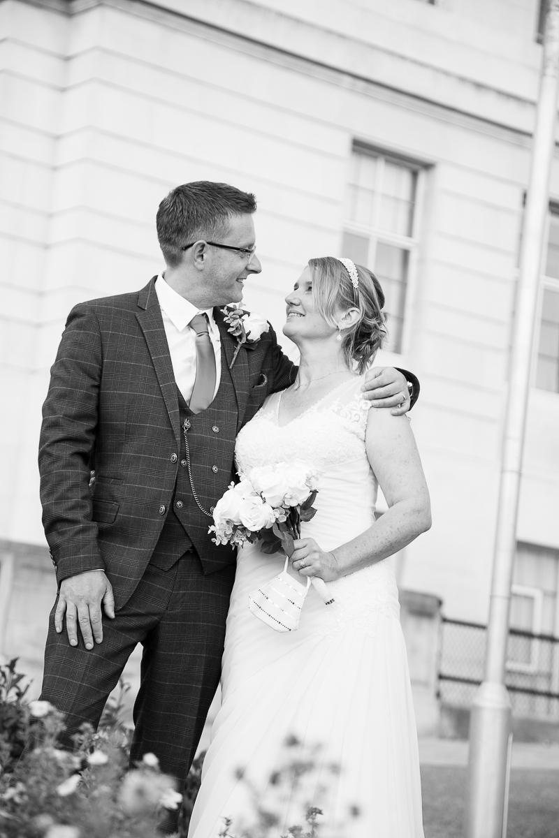 Couple outside Barnsley Town Hall on their wedding day