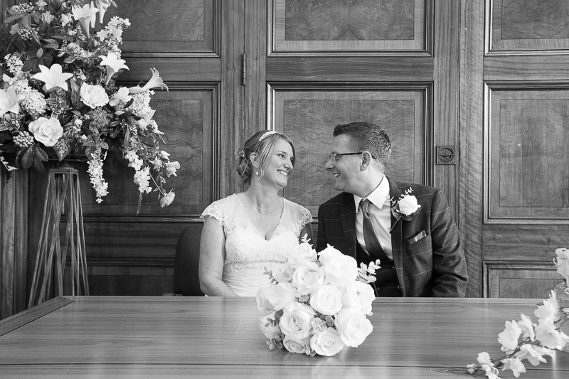 Couple sitting during their wedding ceremony by Wedding Photographer South Yorkshire