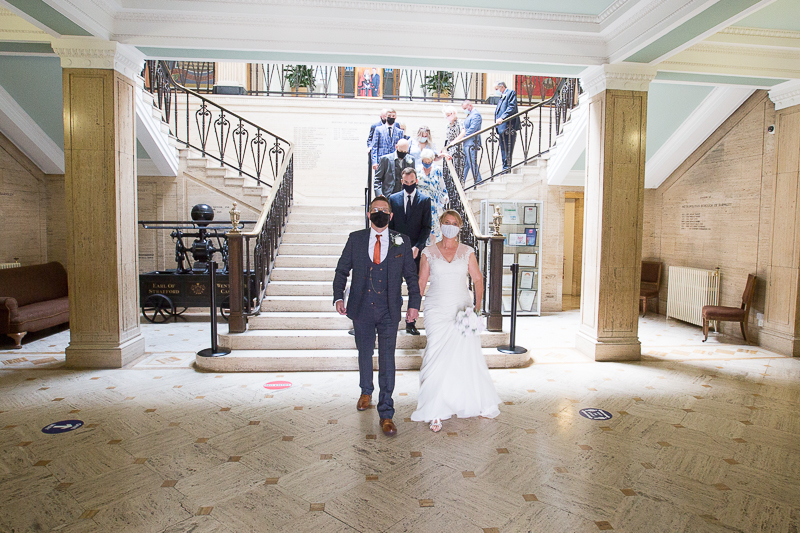 Couple and guests leaving Barnsley Town hall after their wedding