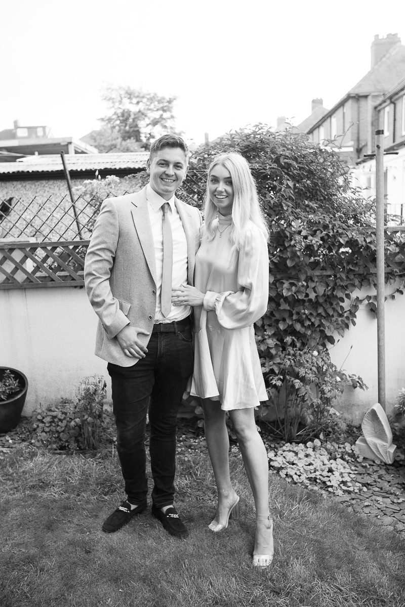 Gusts laugh during back garden wedding reception for a covid wedding