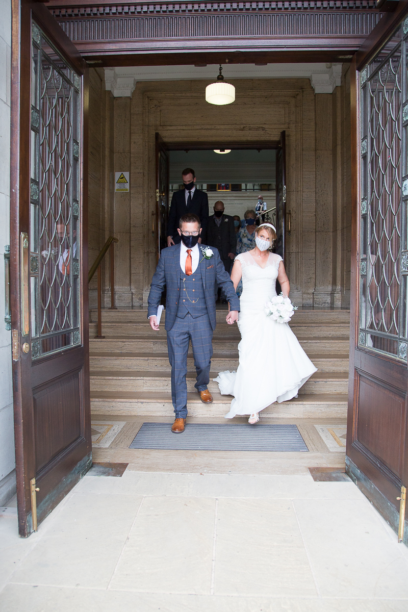 Couple leaving Barnsley Town Hall after their wedding