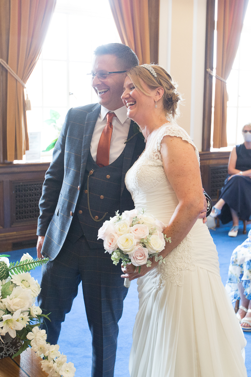 Couple laughing during their wedding ceremony at Barnsley Town Hall