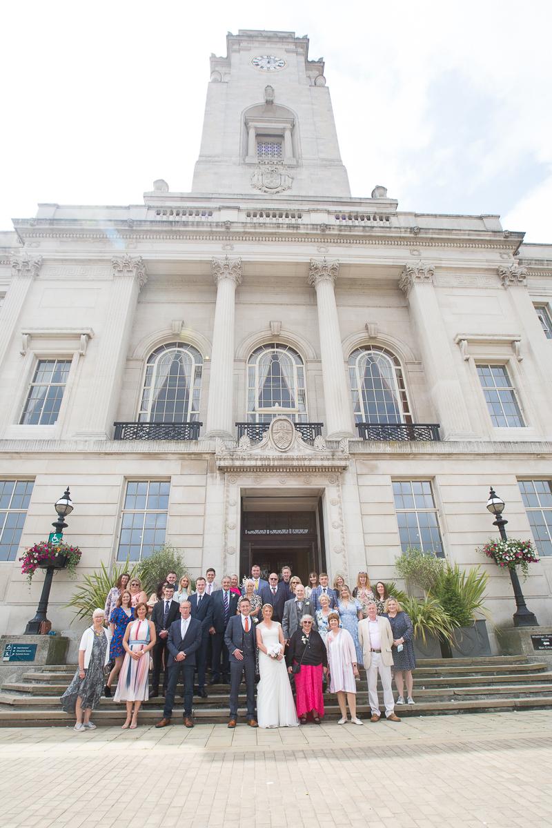 Group shot on the steps of Barnsley Town Hall Wedding Photographer South Yorkshire