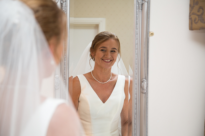 Bride looking in the mirror before the wedding ceremony Wortley Hall Sheffield Wedding