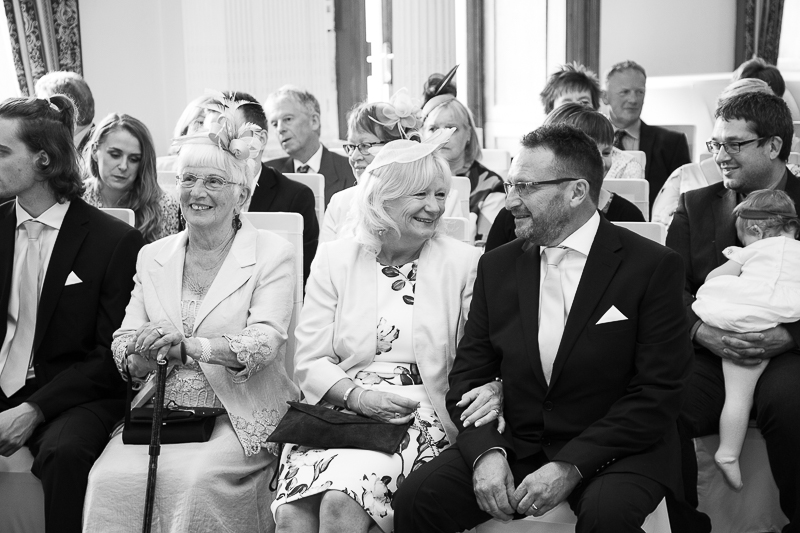 Grooms family smiling in the ceremony room at Wortley Hall Sheffield Wedding