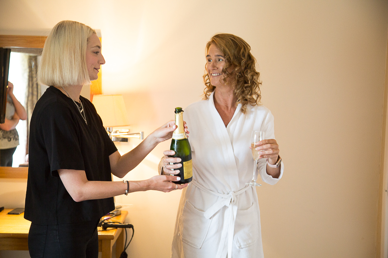 Drinking champagne on the morning of the wedding at Wortley Hall Sheffield Wedding