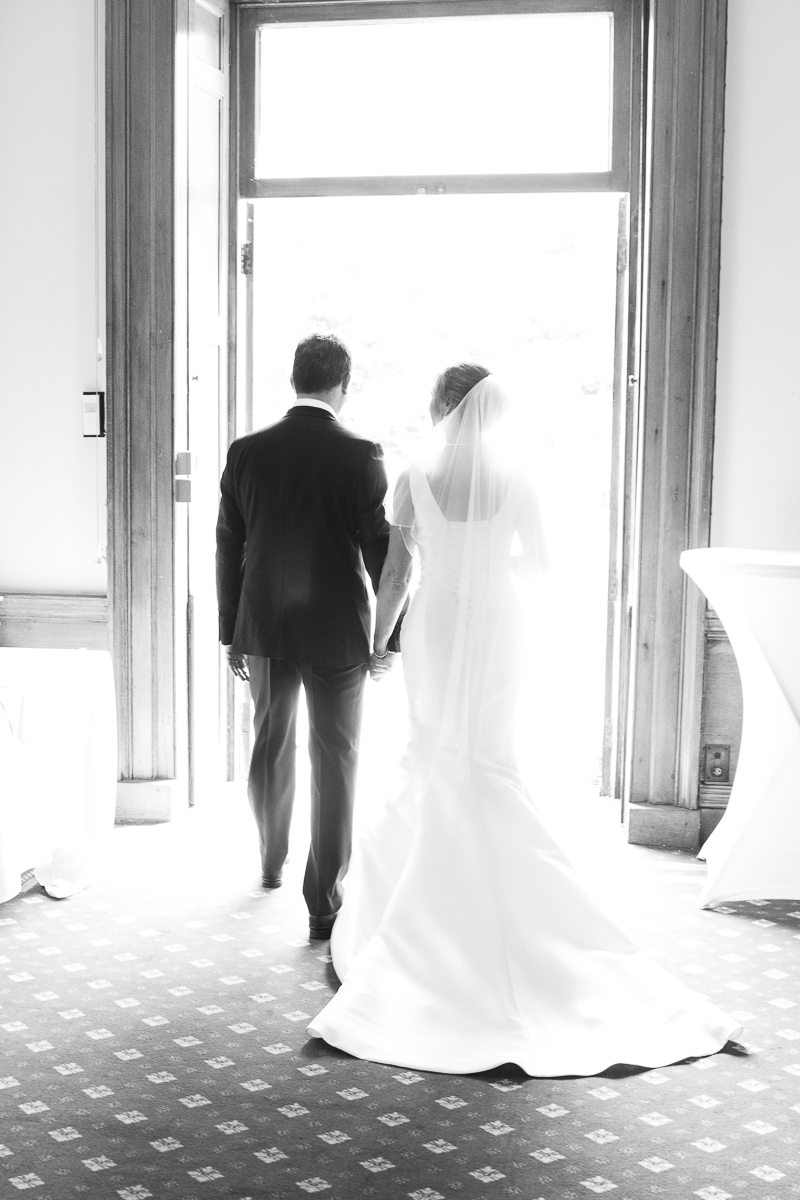 Bride and groom walking out into the grounds at Wortley Hall Hotel