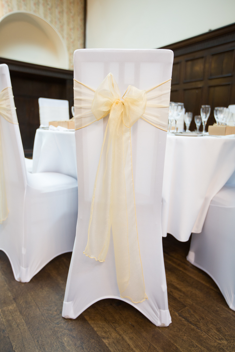 Pale yellow gold chair bow at Wortley Hall Hotel