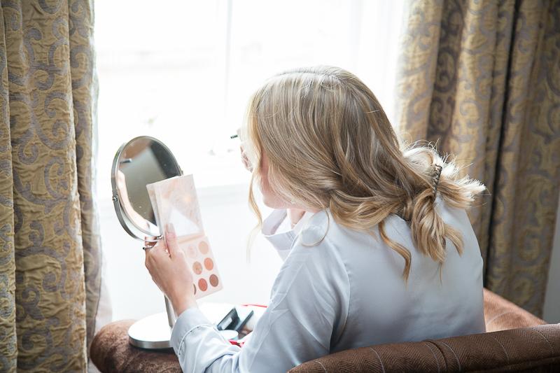 Bridesmaid doing her makeup on the wedding morning Wortley Hall Sheffield Wedding